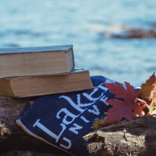 Lakehead University scarf and a stack of books