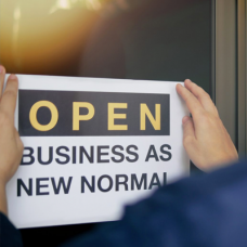 """Sign that reads, """"Open business as new normal."""""""