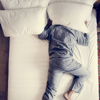 Person sleeping in a bed