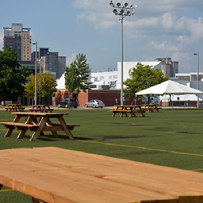 Picnic tables and tents on Alumni Field at Wilfrid Laurier's Waterloo campus